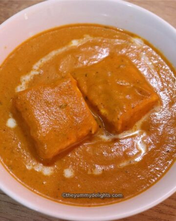 Shahi paneer served in a white bowl.
