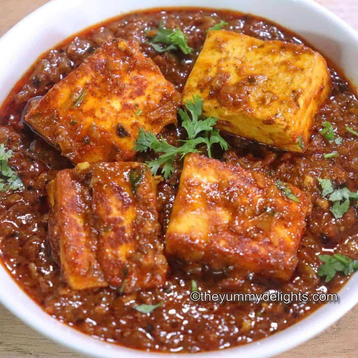 dhaba style paneer masala is served in a pan