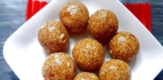 Close up of til ladoo served on a white plate.