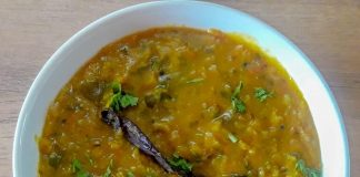 dal fry served in white bowl.