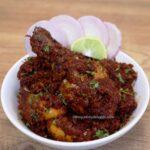 Kolhapuri chicken sukka served in a white bowl.