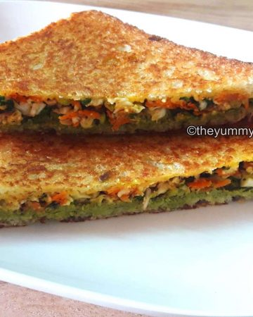Close up of Paneer sandwich served on a white plate.