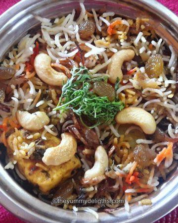 close up of veg biryani in a serving bowl.