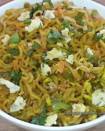 close up of egg maggi served in a whie bowl.