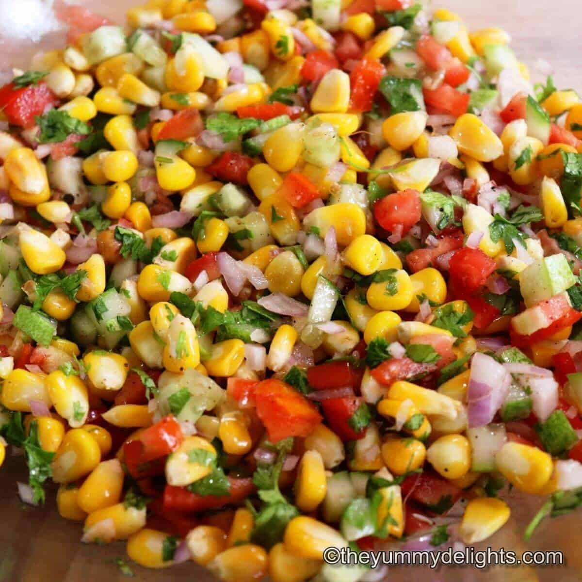 Close up of corn salsa in a mixing bowl.