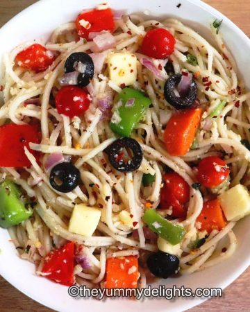 spaghetti salad served in a white bowl.