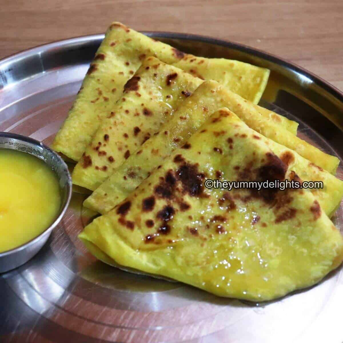 image close-up of Puran Poli served with ghee.