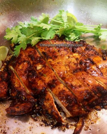 lime cilantro chicken in a pan. This Mexican lime chicken is garnished with cilantro leaves and lime wedges.