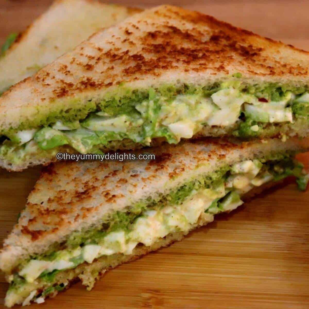 egg salad sandwich placed on a chopping board.