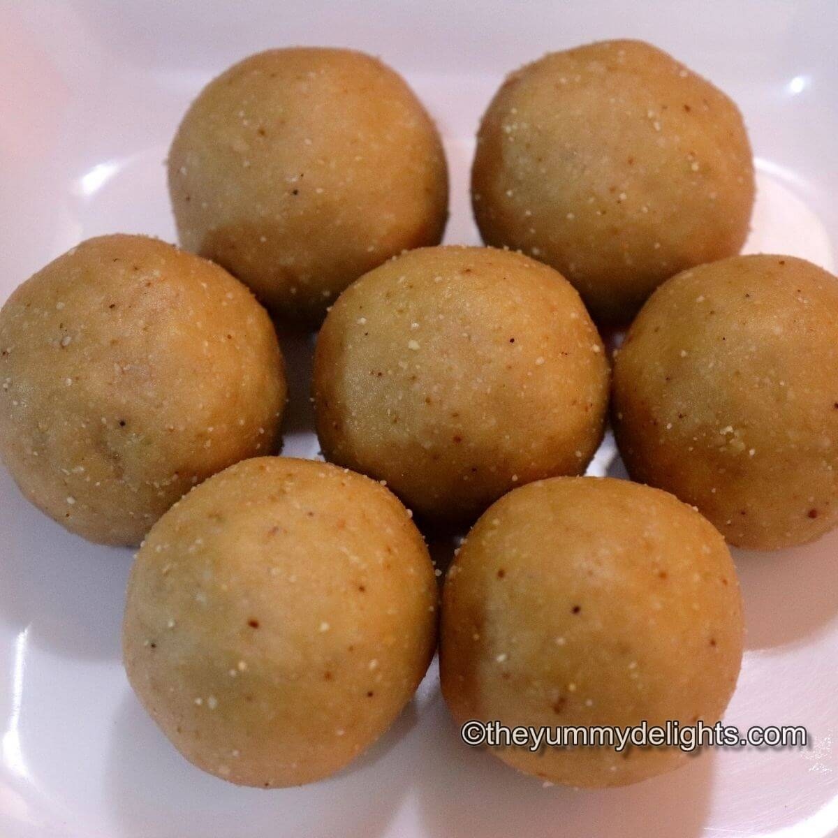 Peanut ladoos placed on a white plate.